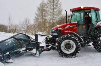 трактор чистит снег,